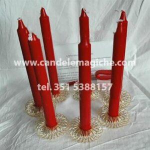 set di candele rosse per il rito nigeriano della mela