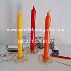 tre candele, gialla rossa e arancione per rituale di san giovanni battista