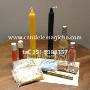 una candela gialla ed una nera ed oli per svolgere il rito della vittoria