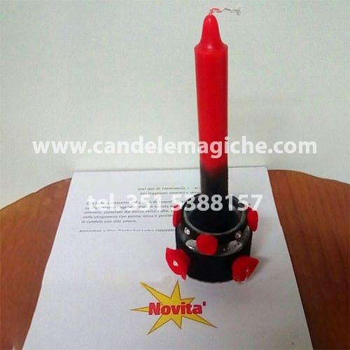 candela rossa e nera e portacandele per rituale di pomba gira