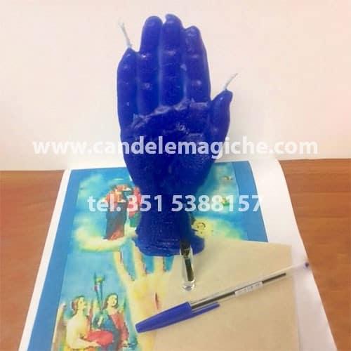 candela azzurra a forma di mano per rituale della mano poderosa