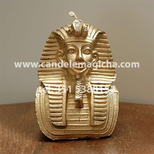 candela raffigurante il busto di faraone egiziano di colore oro